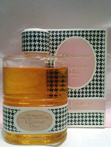 Bottle of vintage Diorissimo eau de toilette in houndstooth box with pink label.