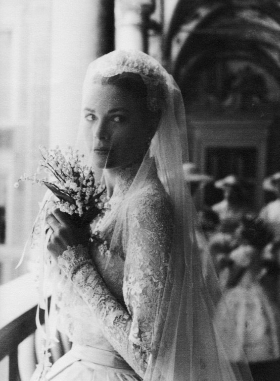 Grace Kelly on the day of her wedding to Prince Rainier of Monaco, holding bouquet of lilies of the valley