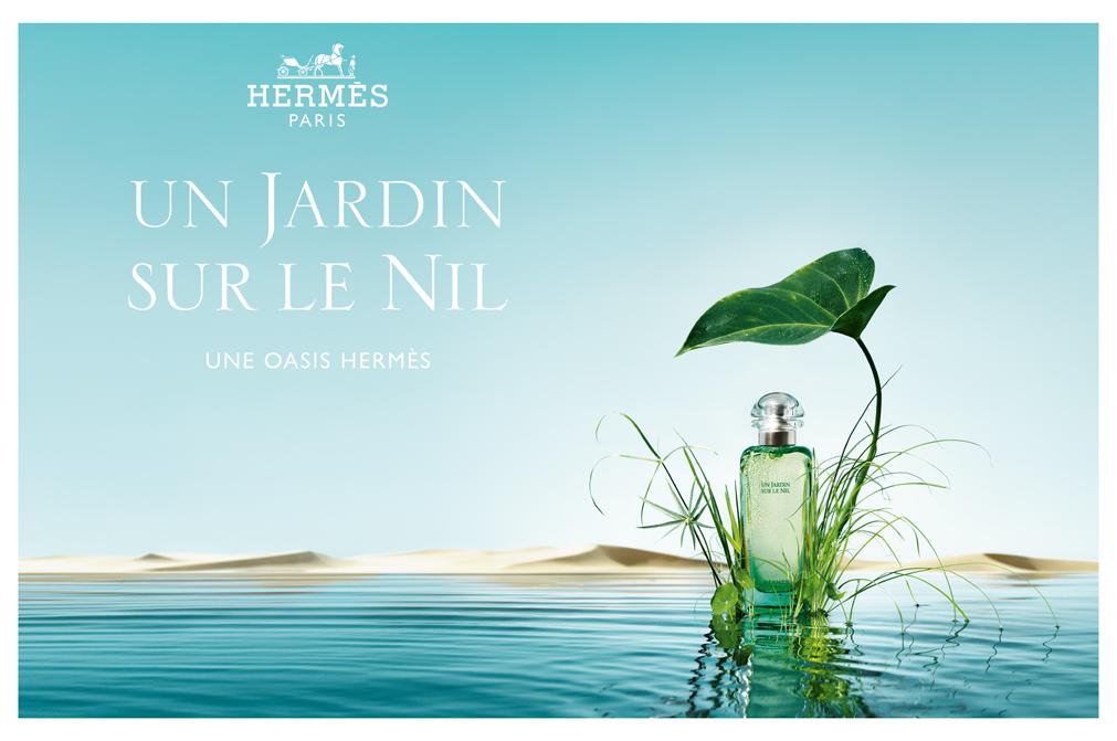 Advertisement for Hermes Un Jardin Sur le Nil, bottle of perfume resting on lotus leaf against background of Nile River
