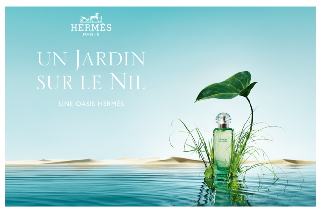 Advertisement for Hermes Un Jardin Sur le Nil, bottle of perfume resting on lotus leaf against background of Nile River
