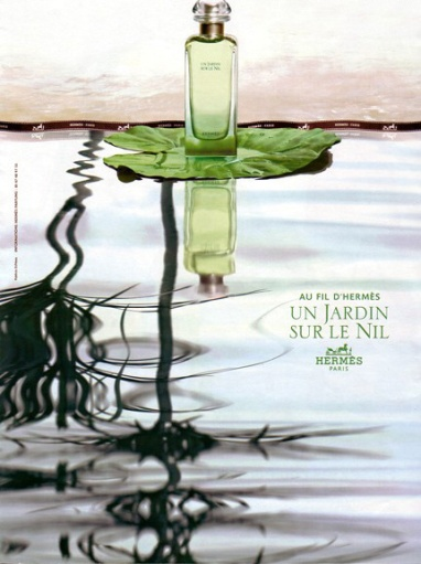 Bottle of Un Jardin Sur le Nil fragrance from Hermes, floating on a lotus leaf