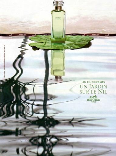 Bottle of Un Jardin Sur le Nil fragrance from Hermes, floating on a lotus leaf