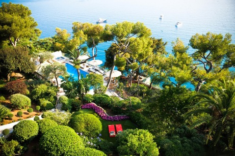 View of the cliff garden, sea and boats, from garden of villa in French Riviera