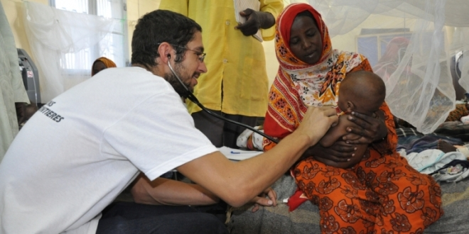 Doctors Without Borders (Medecins Sans Frontieres), treating refugee mother and baby in Africa
