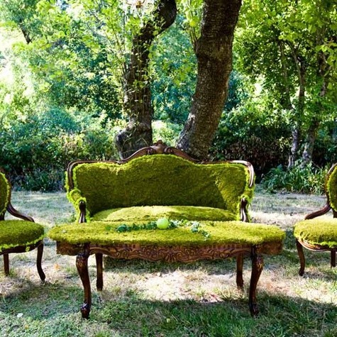 Set of green mossy furniture, chairs, sofa, table, outside.