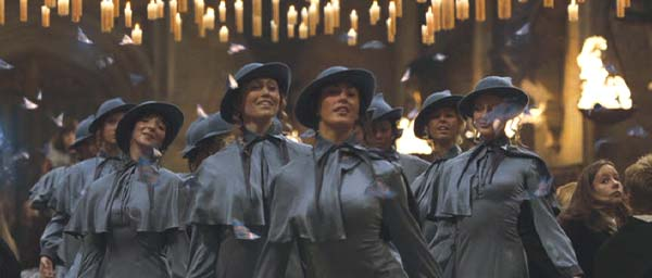 Beauxbatons students entering Hogwarts in blue uniforms with butterflies