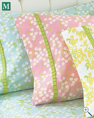 Pillow cases and bed linens by Lilly Pulitzer with lily of the valley print in bright colors