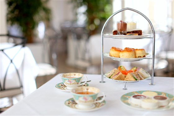 Afternoon tea setting with cakes at Kensington Palace, The Orangery, London
