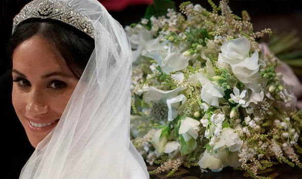 Meghan Markle and her wedding bouquet of white flowers