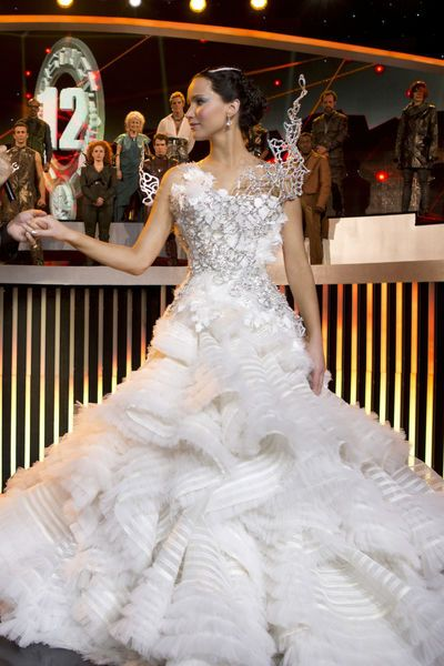 Jennifer Lawrence as Katniss Everdeen in wedding dress, in The Hunger Games: Catching Fire.
