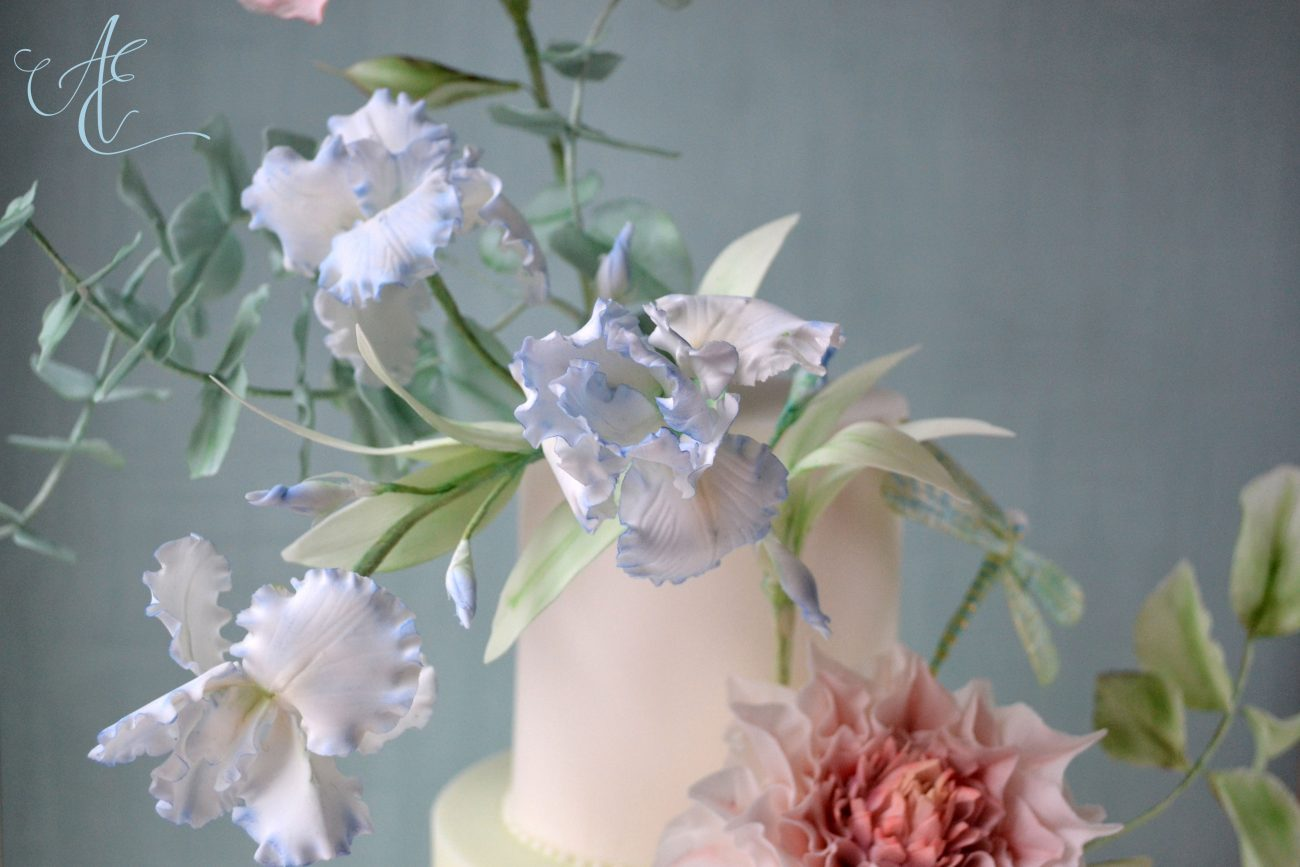 Sugared iris flowers on wedding cake by Amanda Earl
