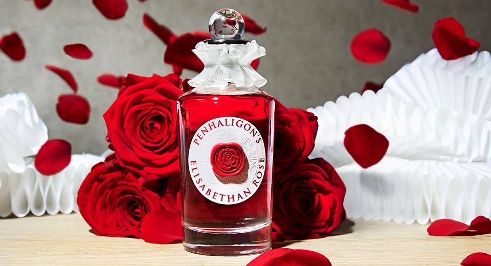 Bottle of Penhaligon's Elisabethan Rose eau de parfum with roses
