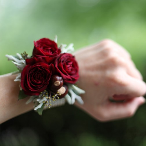 Winter wrist corsage with red roses