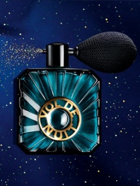 Blue green atomizer bottle of Guerlain's Vol de Nuit shimmer powder