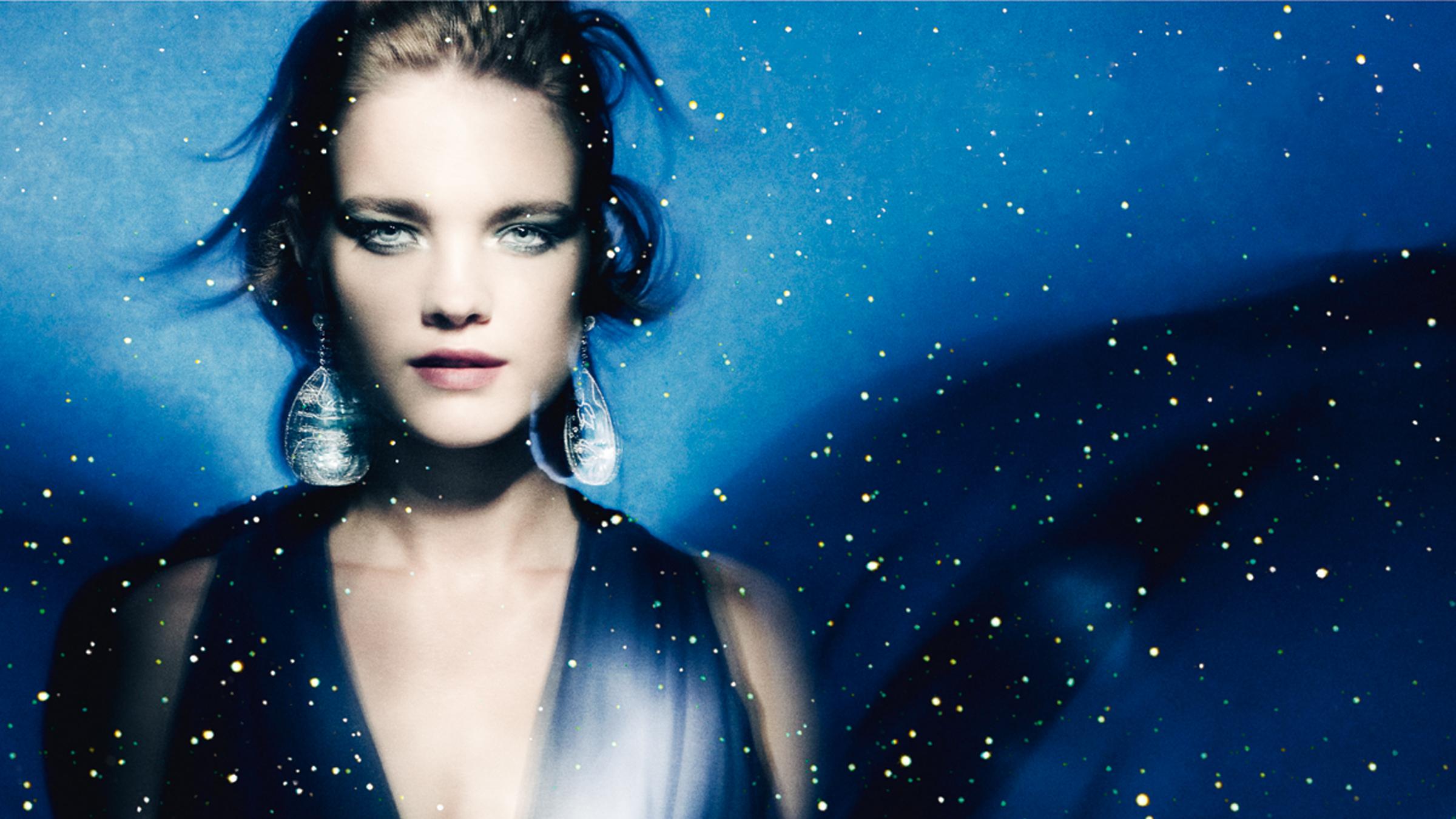 Ad for Guerlain's Vol de Nuit shimmer powder