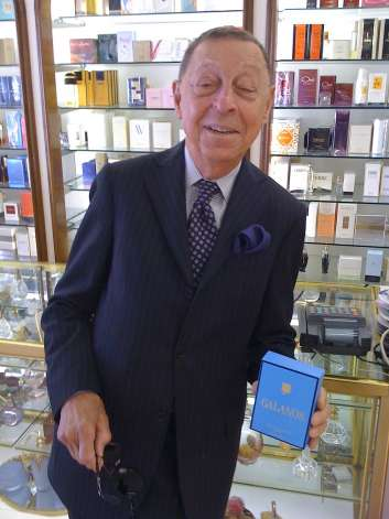 Fashion designer James Galanos in Jacqueline perfume boutique, San Francisco
