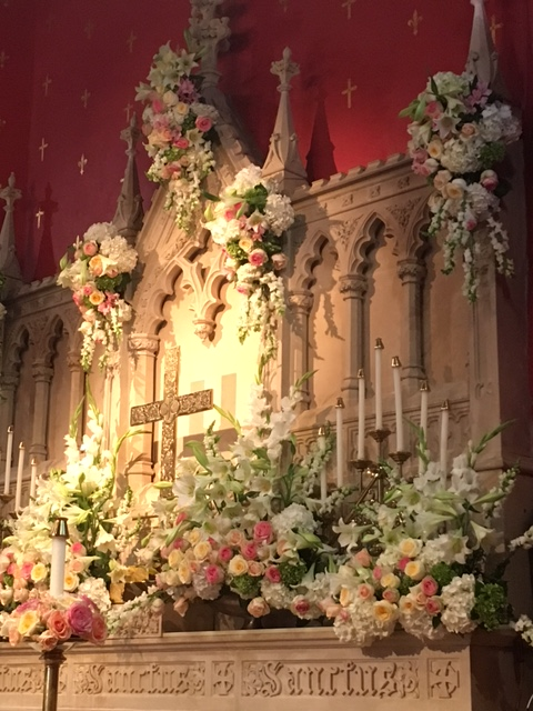 Altar and reredos with flowers for Easter Sunday
