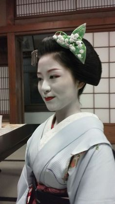 Japanese woman wearing traditional garb with lily of the valley headpiece
