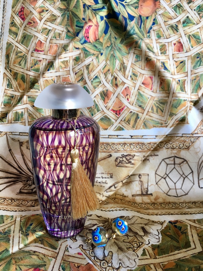 Bottle of Merchant of Venice fragrance Flower Fusion with Murano glass earrings and Massimo Ravinale scarf based on Leonardo da Vinci