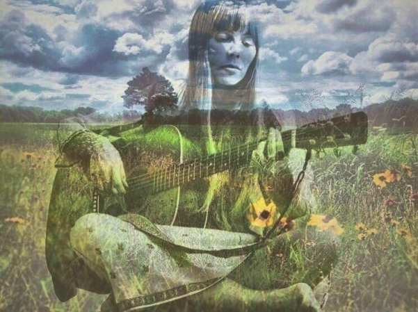 Singer songwriter Joni Mitchell with clouds, wildflowers and guitar