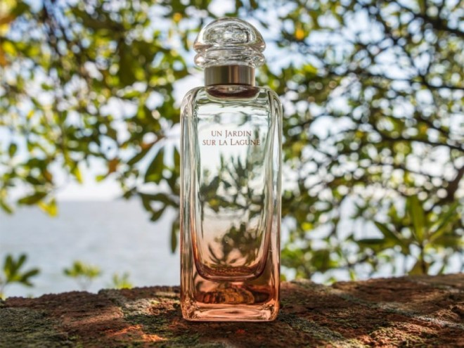 Bottle of Hermes fragrance Un Jardin Sur La Lagune in Venetian landscape