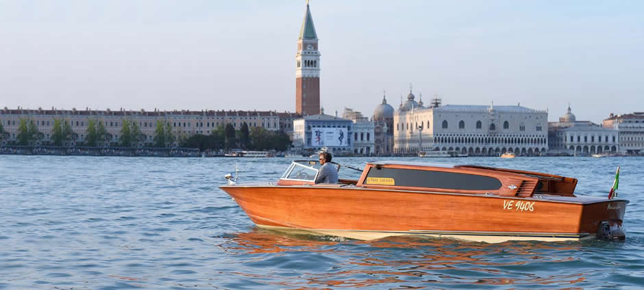 Wooden water taxi in Venice lagoon landscape