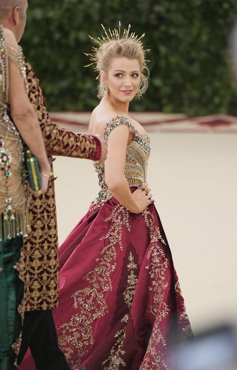 Actress Blake Lively in red velvet Versace gown.