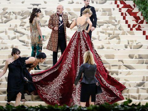 Actress Blake Lively in Versace dress of red velvet.