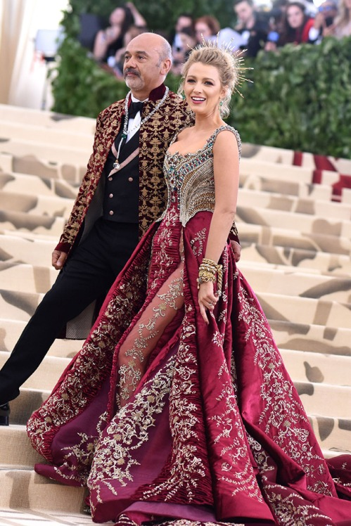 Actress Blake Lively in red jeweled dress at Met Costume Gala