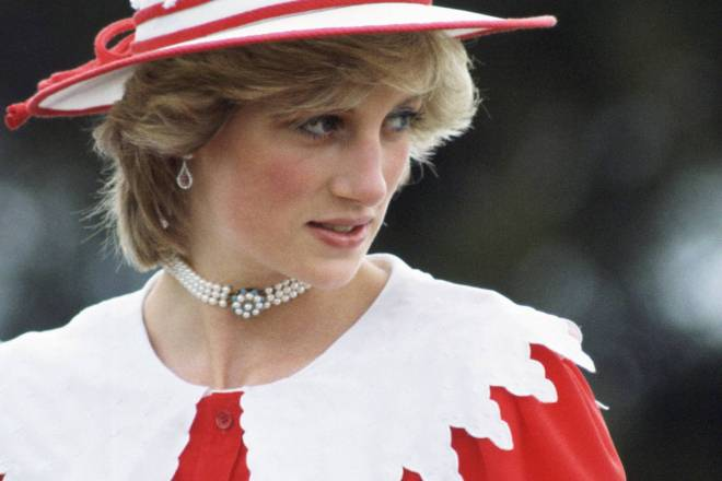Princess Diana in red and white with hat, pearls.