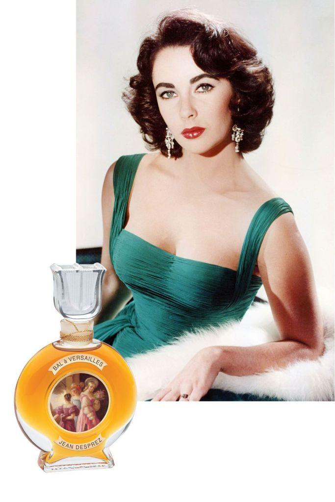 Movie star Liz Taylor with bottle of Bal a Versailles perfume by Jean Desprez.