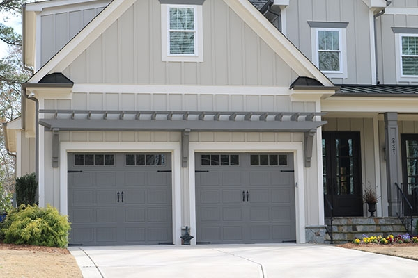 Eyebrow wall pergola over garage doors